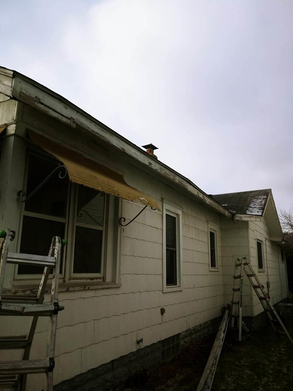 Fascia Replacement and Seamless Gutter Installation - Before