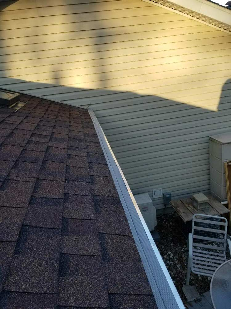 Plastic Gutter Protection Replaced - After