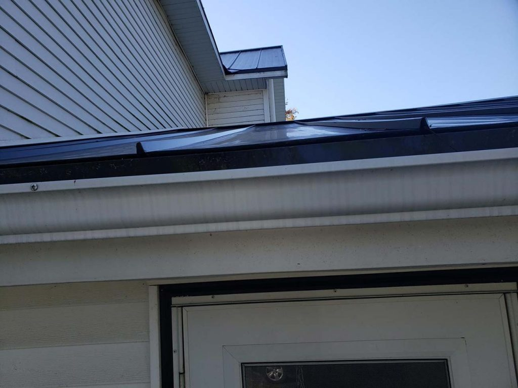 Seamless Gutters, Snow Bars and Gutter Guards Installed - Before